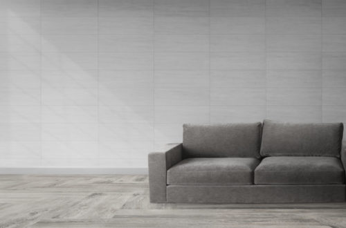 Gray couch against a wall mockup